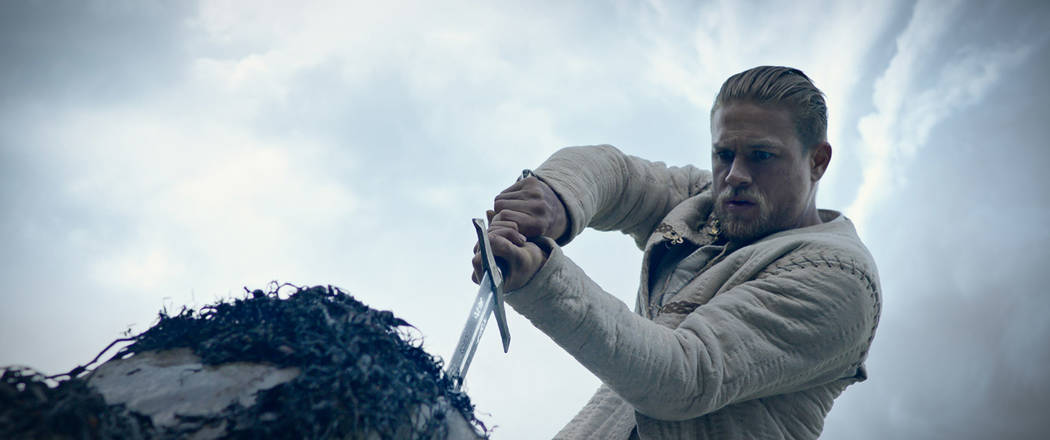 """Caption: Charlie Hunnam as Arthur in Warner Bros. Pictures' and Village Roadshow Pictures' fantasy action adventure """"King Arthur: Legend of the Sword."""" Warner Bros. Pictures"""