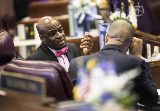 Sen. Kelvin Atkinson, D-North Las Vegas, left, speaks with Senate Majority Leader Aaron Ford, D-Las Vegas, in the Senate Chambers during the third day of the Nevada Legislative session on Wednesda ...