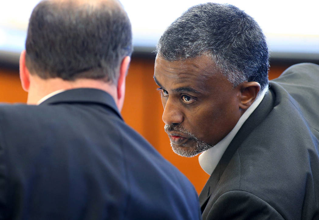 FILE - In this Dec. 29, 2015 file photo, Fanuel Gebreyes, right, father of Aden Hailu, talks to his attorney David O'Mara during a hearing in Washoe County District Court in Reno, Nev. Hailu, a 20 ...
