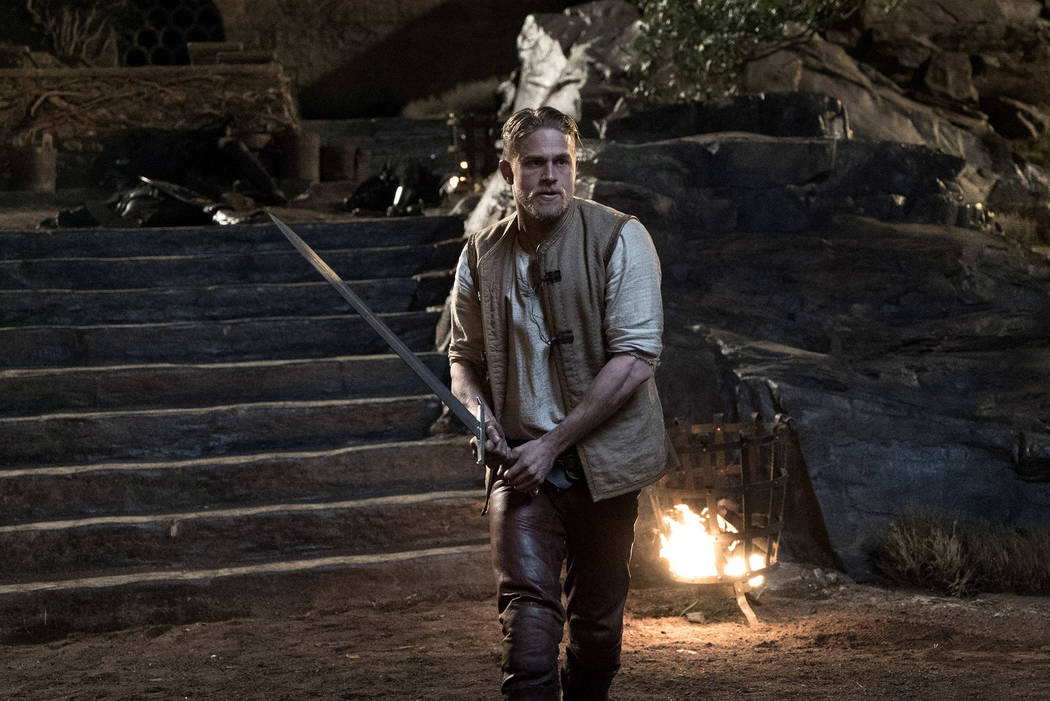 "Charlie Hunnam as Arthur in Warner Bros. Pictures' and Village Roadshow Pictures' fantasy action adventure ""King Arthur: Legend of the Sword."" Daniel Smith"