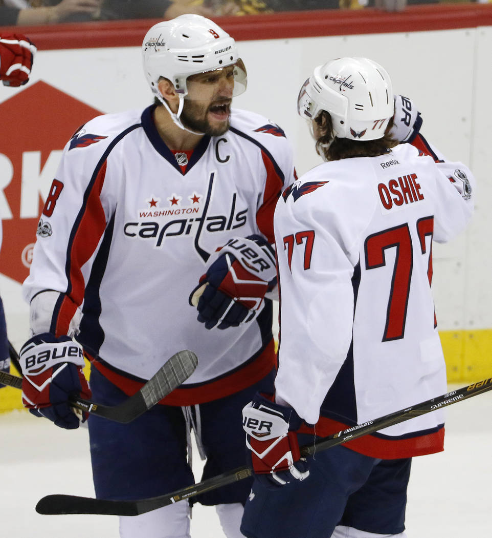Washington Capitals' T.J. Oshie (77) celebrates his goal with Alex Ovechkin in the first period of Game 6 in an NHL Stanley Cup Eastern Conference semifinal hockey game against the Pittsburgh Peng ...
