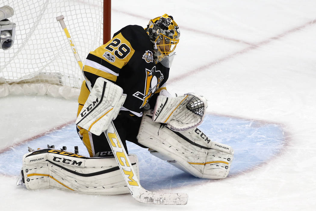 Pittsburgh Penguins goalie Marc-Andre Fleury makes a save during the first period of Game 6 in an NHL Stanley Cup Eastern Conference semifinal hockey game against the Washington Capitals in Pittsb ...