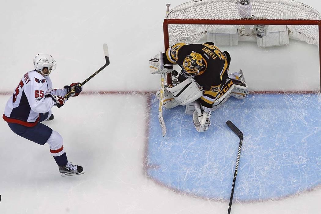 Washington Capitals' Andre Burakovsky (65) a shot past Pittsburgh Penguins goalie Marc-Andre Fleury (29) for a goal during the second period of Game 6 in an NHL Stanley Cup Eastern Conference semi ...