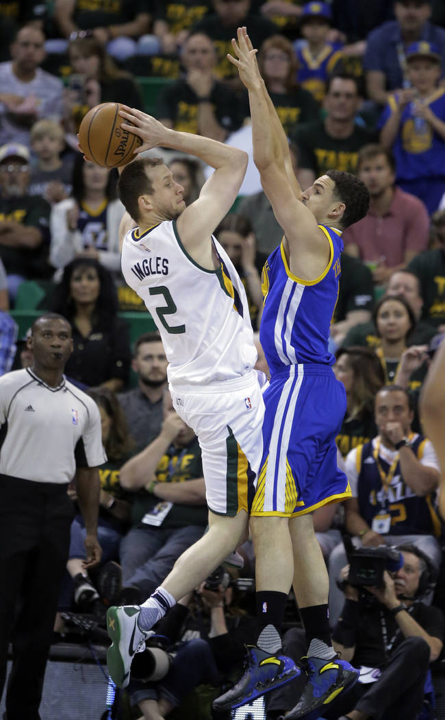 Utah Jazz forward Joe Ingles (2) goes to the basket as Golden State Warriors guard Klay Thompson, right, defends in the first half during Game 4 of the NBA basketball second-round playoff series,  ...