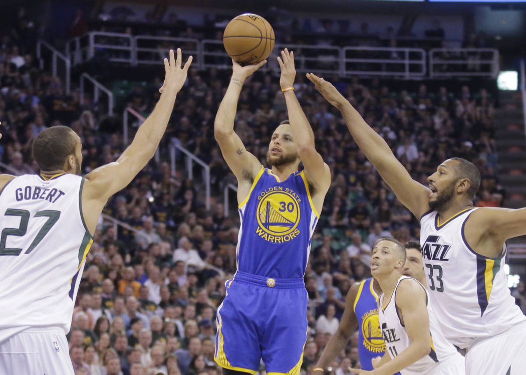 Golden State Warriors guard Stephen Curry (30) shoots as Utah Jazz's Rudy Gobert (27) and Boris Diaw (33) defend in the first half during Game 4 of the NBA basketball second-round playoff series,  ...