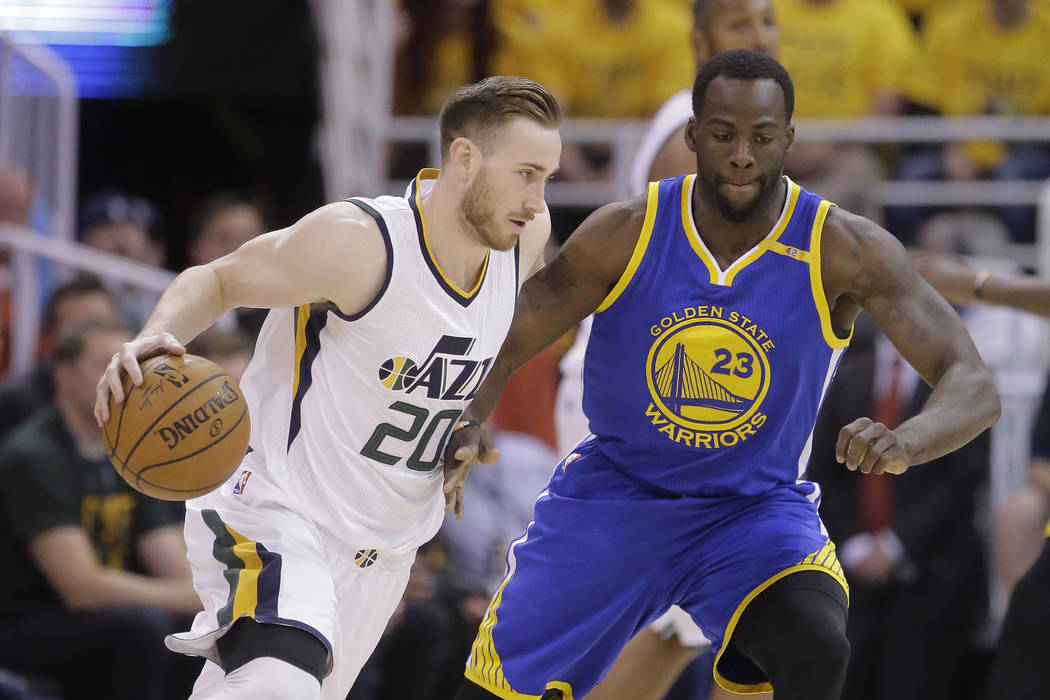 Utah Jazz forward Gordon Hayward (20) drives as Golden State Warriors forward Draymond Green (23) defends in the first half during Game 4 of the NBA basketball second-round playoff series, Monday, ...