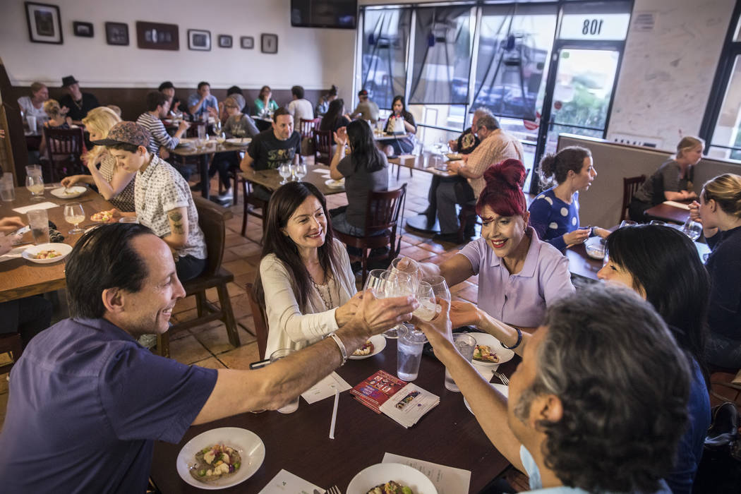 Guests toast to the fourth course of ten beans with artichokes and corn nage during a pop-up dinner to preview chef Jose Navarro's upcoming restaurant Plantivore on Monday, May 8, 2017, in Henders ...