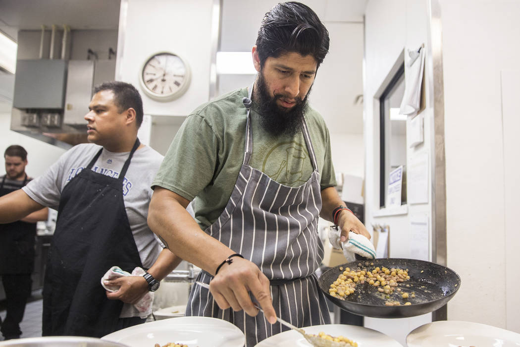 Chef Jose Navarro prepares ten beans with artichokes and corn nage during a pop-up dinner to preview his upcoming restaurant Plantivore on Monday, May 8, 2017, in Henderson. Benjamin Hager Las Veg ...