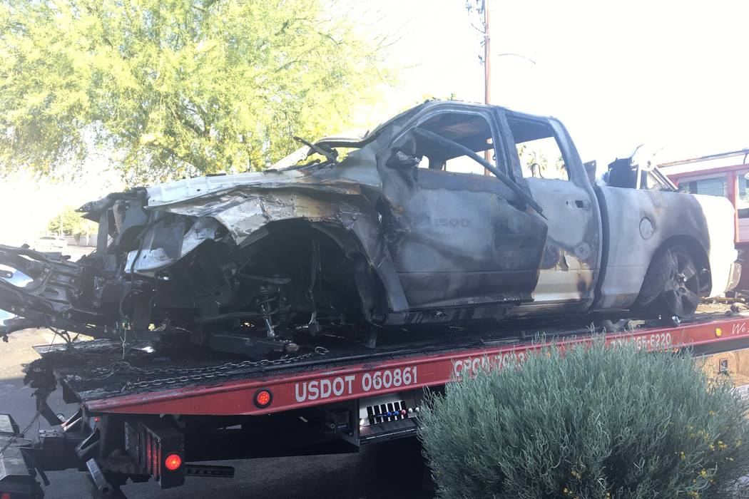 A pickup caught fire after it crashed into three cars and a utility pole at Eastern Avenue and Desert Inn Road Tuesday morning, May 9, 2017. (Bizuayehu Tesfaye/Las Vegas Review-Journal @bizutesfaye)