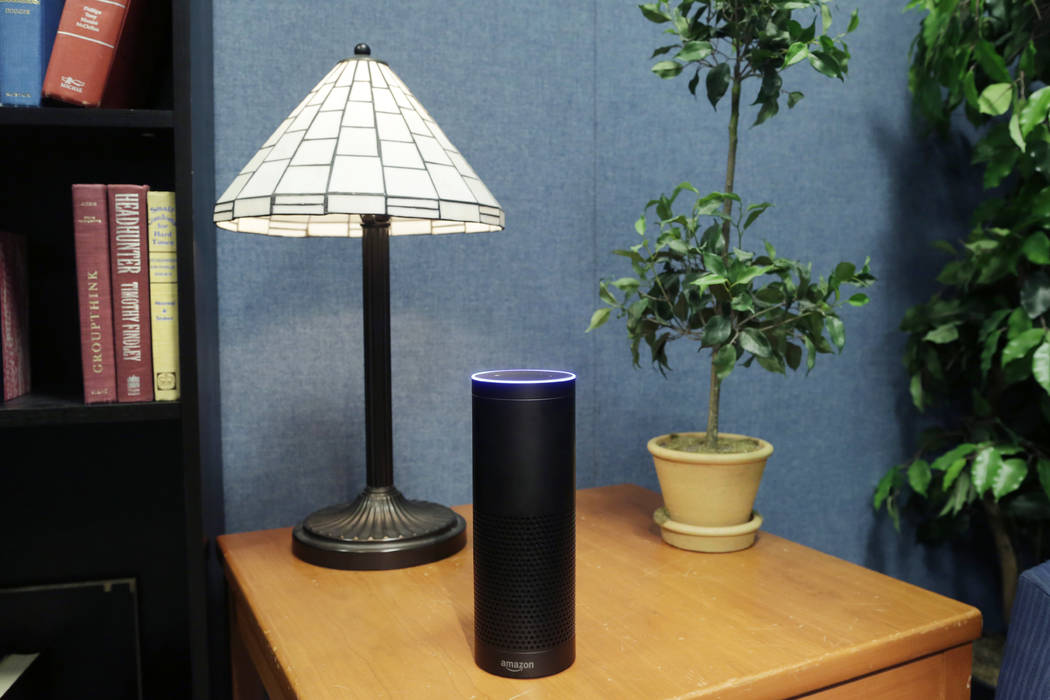 Amazon's Echo, a digital assistant that can be set up in a home or office to listen for various requests, such as for a song, a sports score, the weather, or even a book to be read aloud, is shown ...