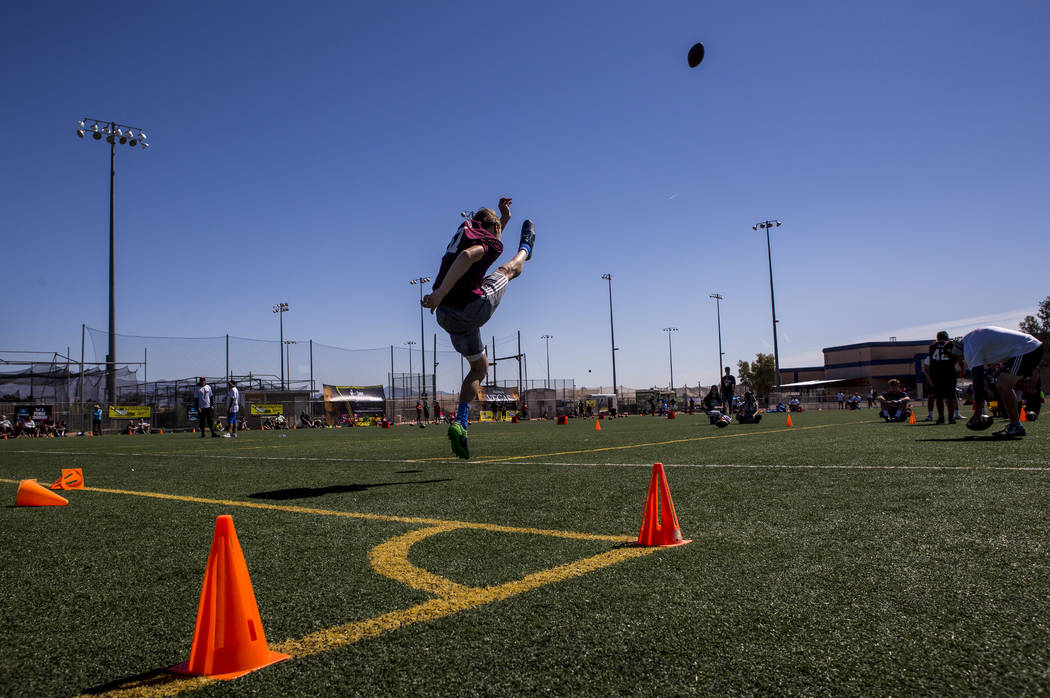 Ethan Schroeder of Newport Beach, Calif., practices punting during the Chris Sailer Kicking National Camp in Las Vegas on Sunday, May 14, 2017. Patrick Connolly Las Vegas Review-Journal @PConnPie