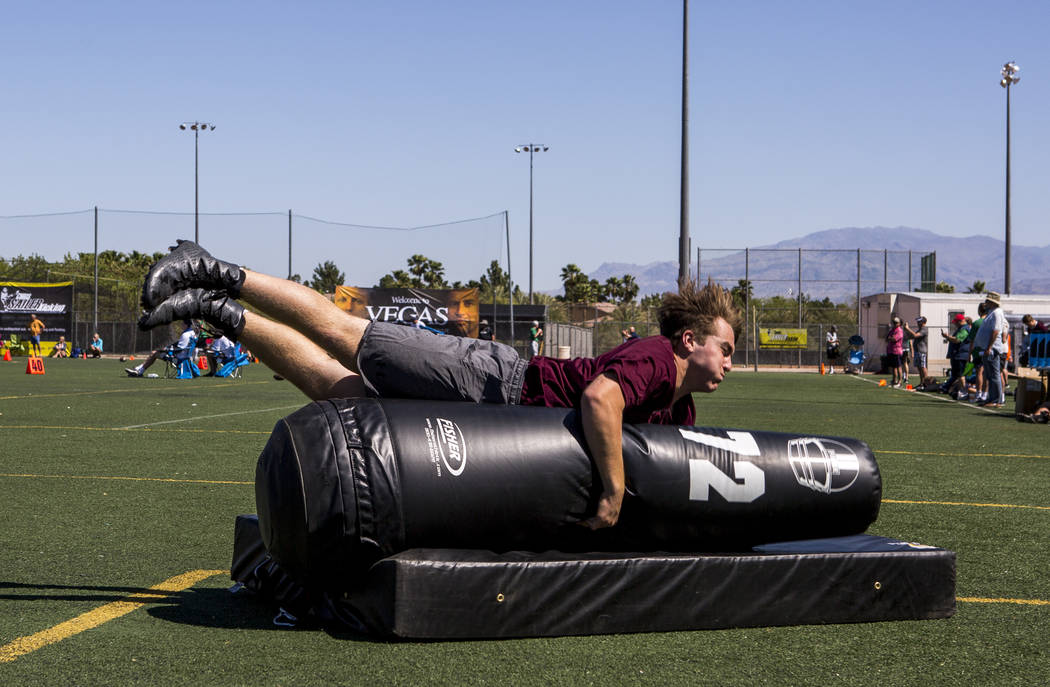 Jack Harrison of Mississippi practices tackling at the end of the agility course during the Chris Sailer Kicking National Camp in Las Vegas on Sunday, May 14, 2017. Patrick Connolly Las Vegas Revi ...
