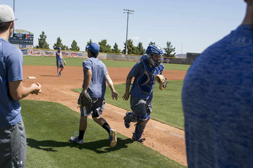 College of Southern Nevada baseball player Nicco Festa, right, receives a high five after running a play during a practice at Morse Stadium on Tuesday, May 16, 2017, in Henderson.  Bridget Bennett ...