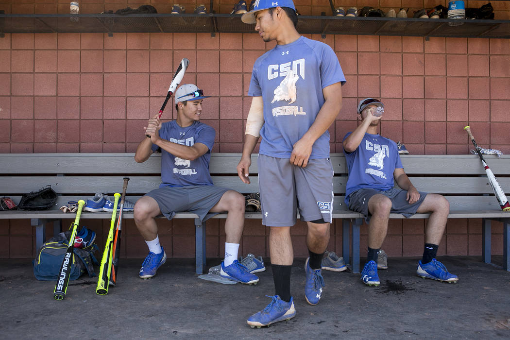 College of Southern Nevada baseball players Joey O'Brien, left, Jordan Macias, center, and Todd Danzeisen, right, gather in the dugout during a practice at Morse Stadium on Tuesday, May 16, 2017,  ...