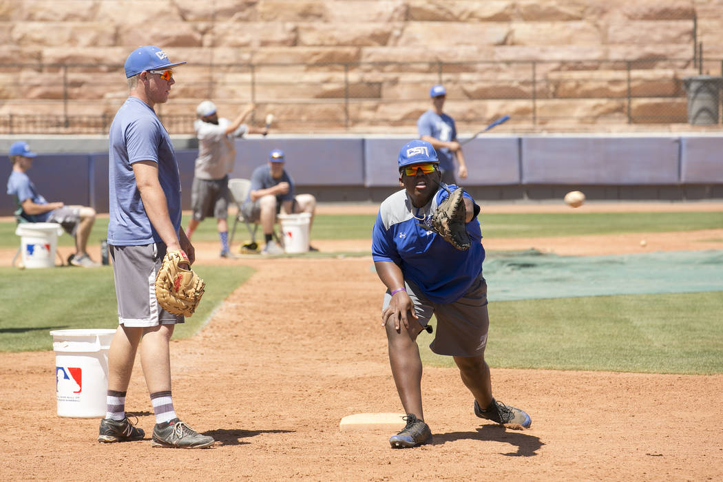 College of Southern Nevada baseball players, Jason Wallace, right, and Justin Lutes, left, run drills during a practice at Morse Stadium on Tuesday, May 16, 2017, in Henderson.  Bridget Bennett La ...