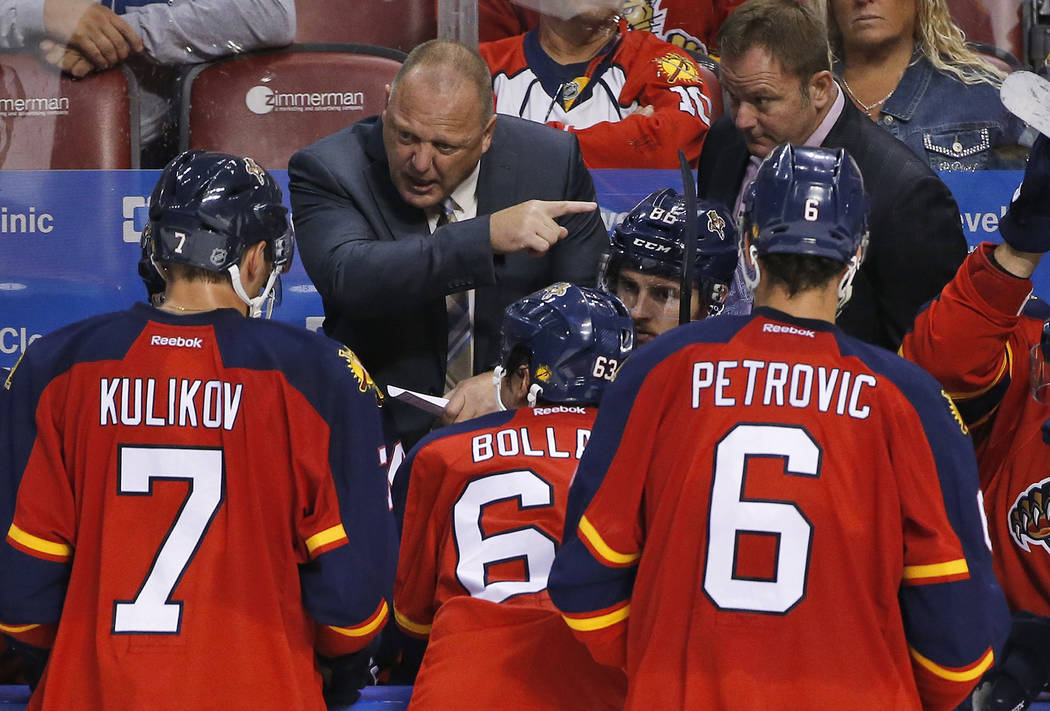 Florida Panthers head coach Gerard Gallant, rear, gestures as he talks to players during the third period of an NHL hockey game against the Buffalo Sabres, Thursday, Oct. 15, 2015 in Sunrise, Fla. ...