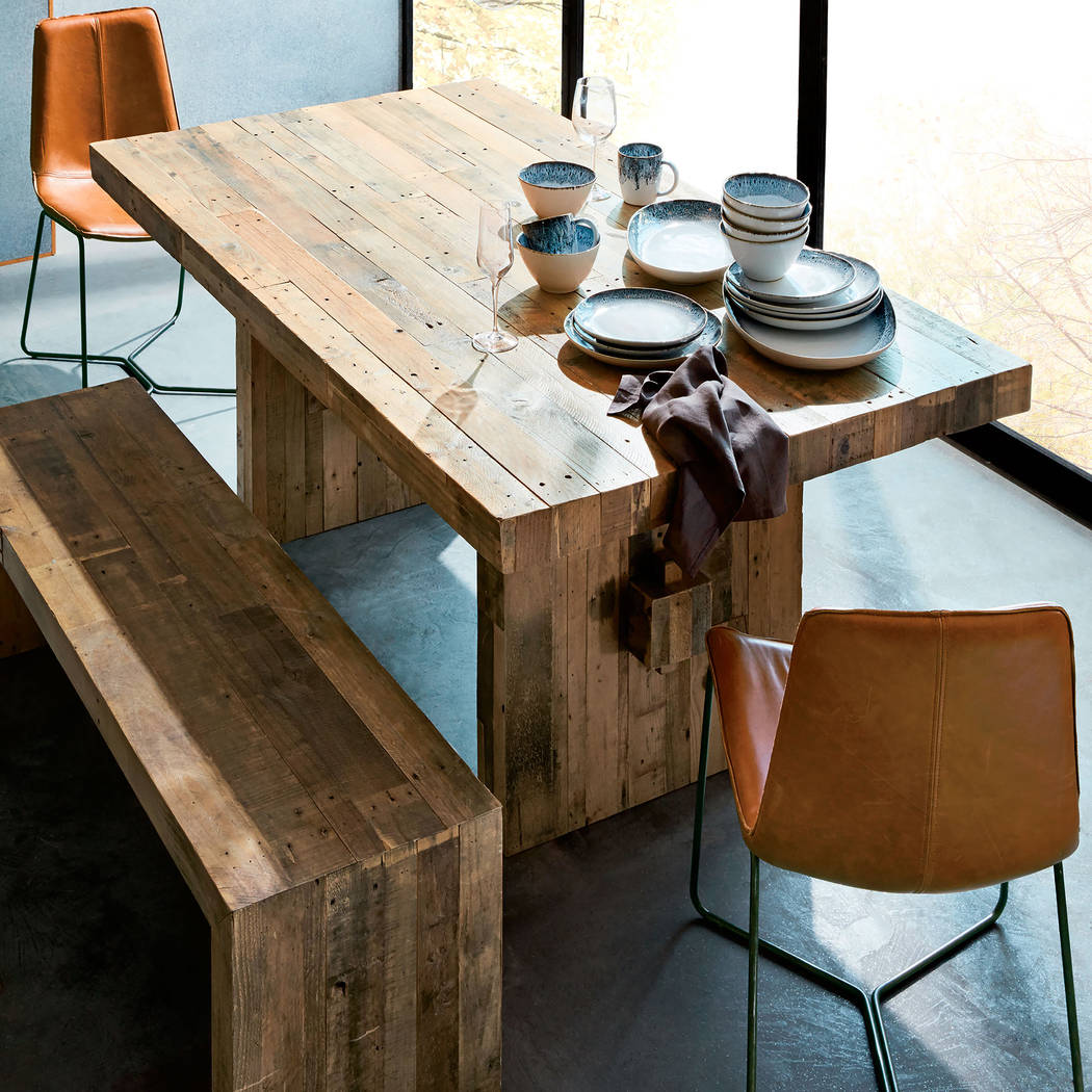 West Elm Made from unfinished reclaimed pine, West Elm's Emmerson dining table shows the knots and natural imperfections that make each piece subtly one of a kind.
