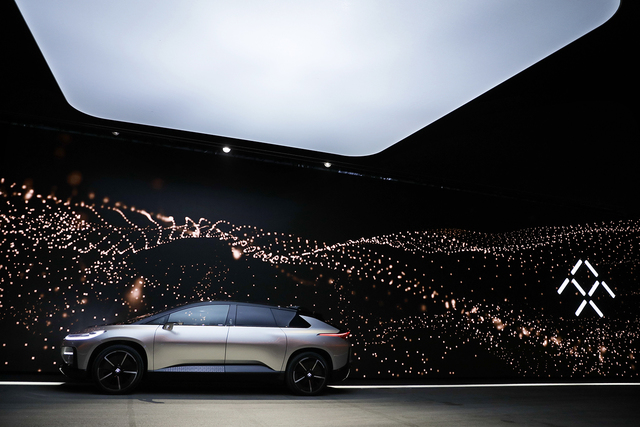 Faraday Future's FF 91 electric car is unveiled during a news conference at CES International Tuesday, Jan. 3, 2017, in Las Vegas. (AP Photo/Jae C. Hong)