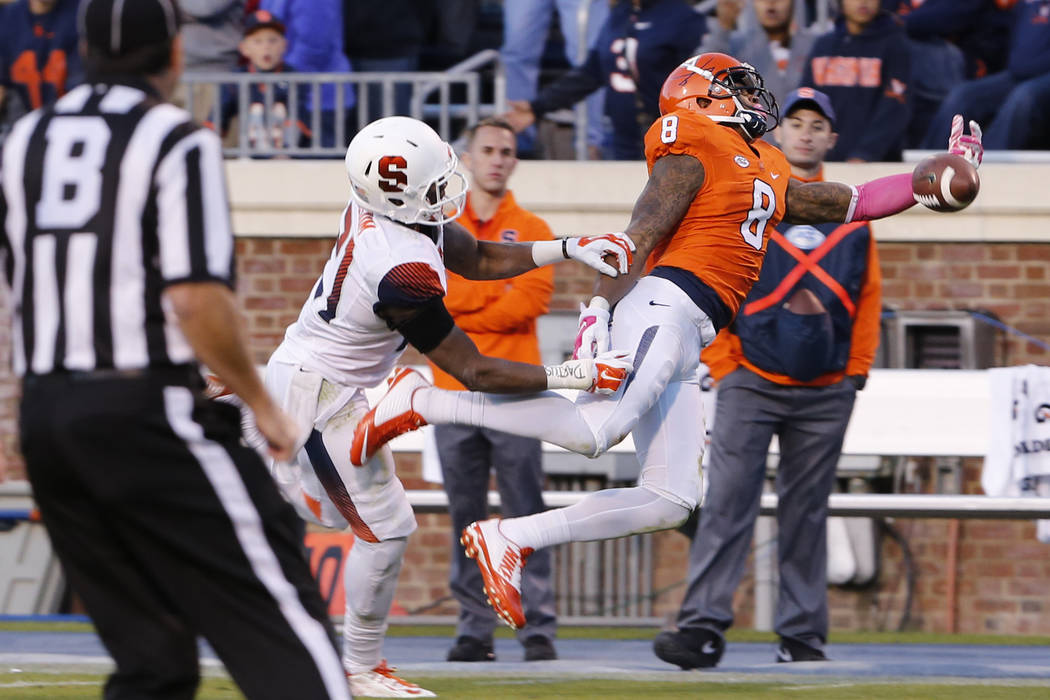 Virginia wide receiver T.J. Thorpe (8) misses a pass as Syracuse safety Chauncey Scissum (21) defendsduring the second half of an NCAA college football game at Scott Stadium in Charlottesville, Va ...