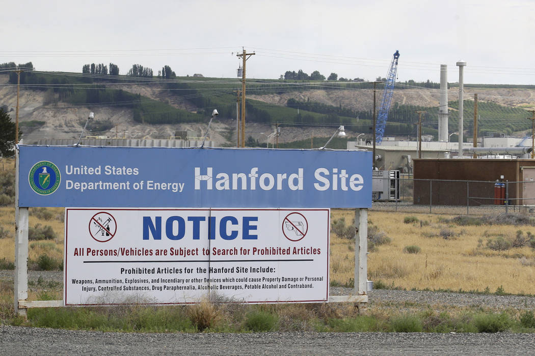 A sign informs visitors of prohibited items on the Hanford Nuclear Reservation near Richland, Wash. on  July 9, 2014. (Ted S. Warren/AP)