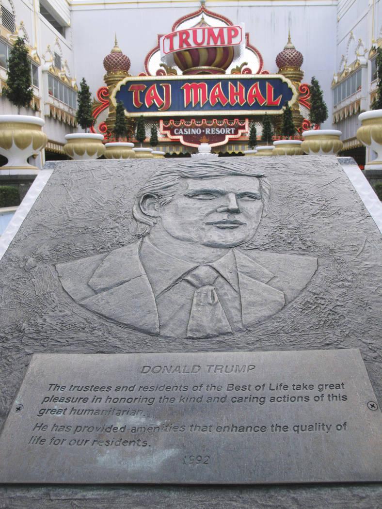 A plaque bearing the likeness of Donald Trump at the entrance to the Trump Taj Mahal Casino resort in Atlantic City, N.J., Nov. 3, 2014. (Wayne Parry/AP)