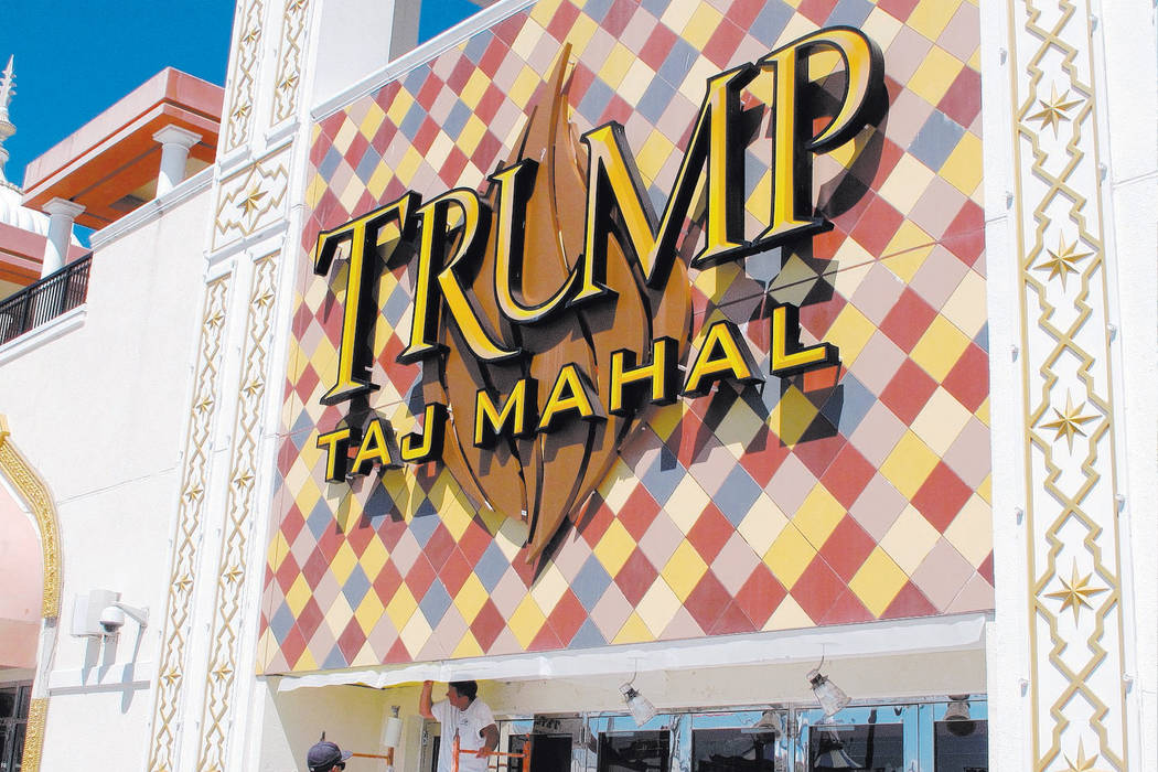 A worker carries out repairs to a facade of the Trump Taj Mahal casino in Atlantic City, N.J. on Thursday Aug. 4, 2016. The Taj Mahal went for 4 cents on the dollar when it was sold in March 2017. ...