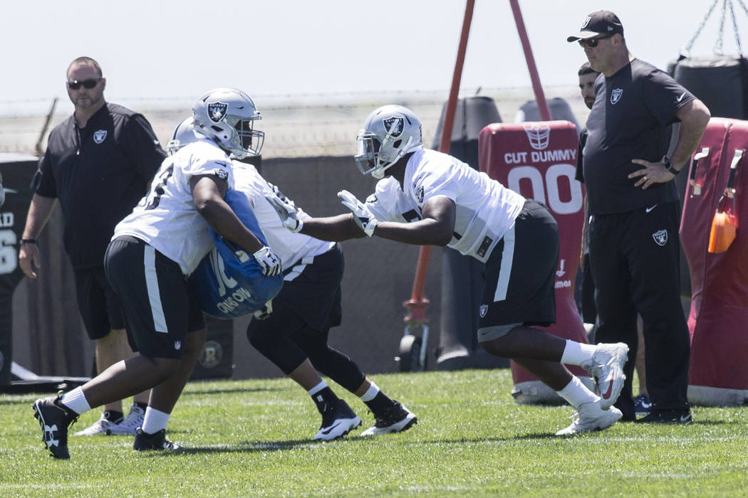Raiders fourth-round draft pick David Sharpe, second from right, works through offensive lineman drills during rookie minicamp on Friday, May 5, 2017, at Oakland Raiders Headquarters, in Alameda,  ...