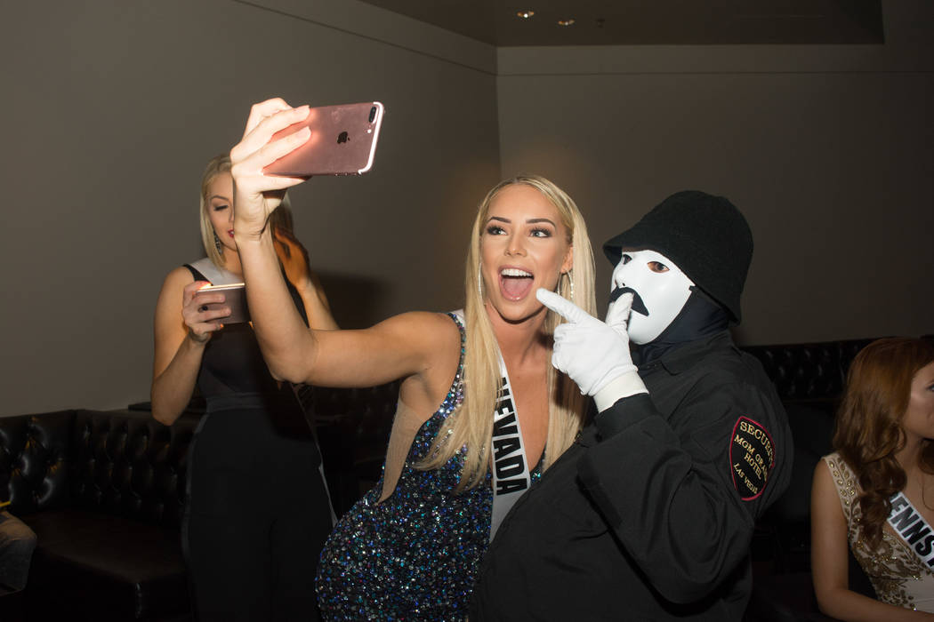 2017 Miss Nevada Lauren York takes a photo with a performer from Jabbawockeez at MGM Grand on Sunday, May 7, 2017, in Las Vegas. (Miss Universe Organization)