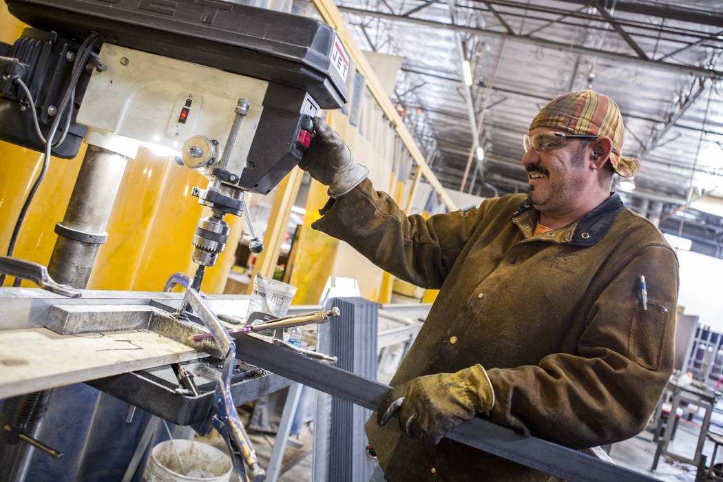 Fransisco Olagee works on drilling holes in pieces of metal at Gist Specialties, which makes custom wood and metal fabrications, in North Las Vegas on Wednesday, May 10, 2017. Patrick Connolly Las ...