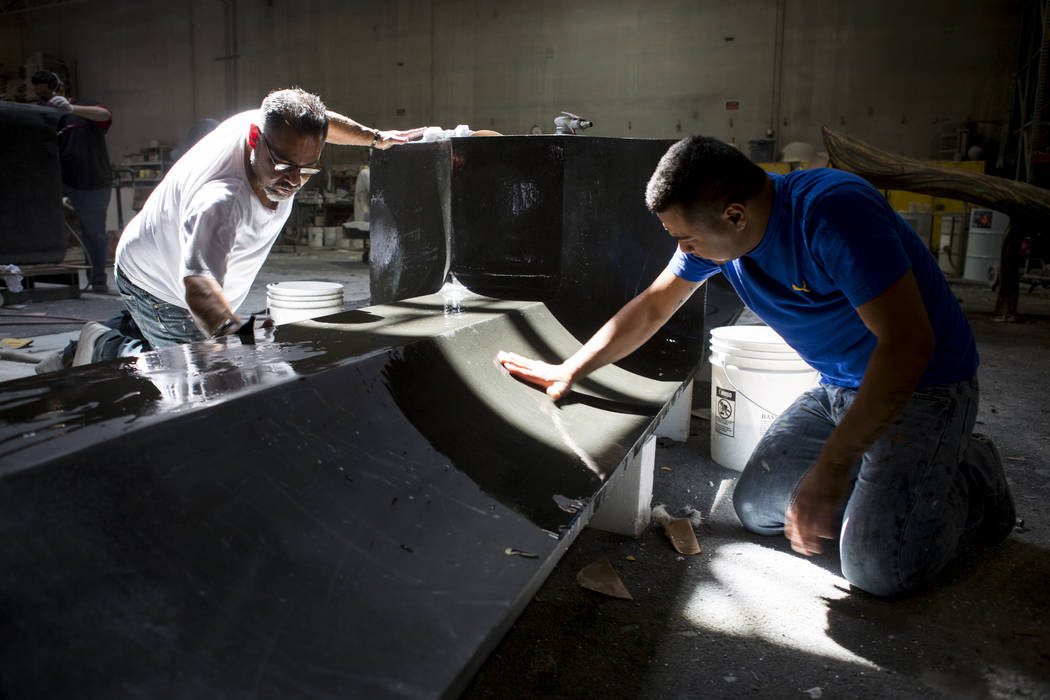 Oscar Perez-Casiano, right, and Carlos Barragan work on finishing a piece Gist Specialties, which makes custom wood and metal fabrications, in North Las Vegas on Wednesday, May 10, 2017. Patrick C ...