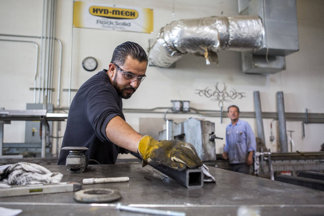Roy Ibarra works on pieces of a metal frame at Gist Specialties, which makes custom wood and metal fabrications, in North Las Vegas on Wednesday, May 10, 2017. Patrick Connolly Las Vegas Review-Jo ...