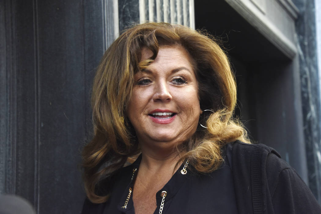 "TV personality Abby Lee Miller of ""Dance Moms"" arrives at court in downtown Pittsburgh for the second day of her sentencing hearing, Tuesday, May 9, 2017.  A federal judge sentenced the former ""Da ..."