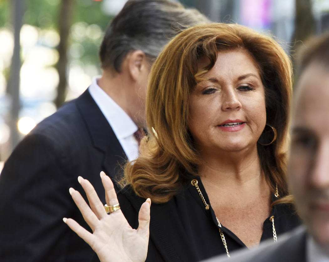 "TV personality Abby Lee Miller arrives at court in downtown Pittsburgh, for the second day of her sentencing hearing, Tuesday, May 9, 2017.  A federal judge sentenced the former ""Dance Moms"" reali ..."
