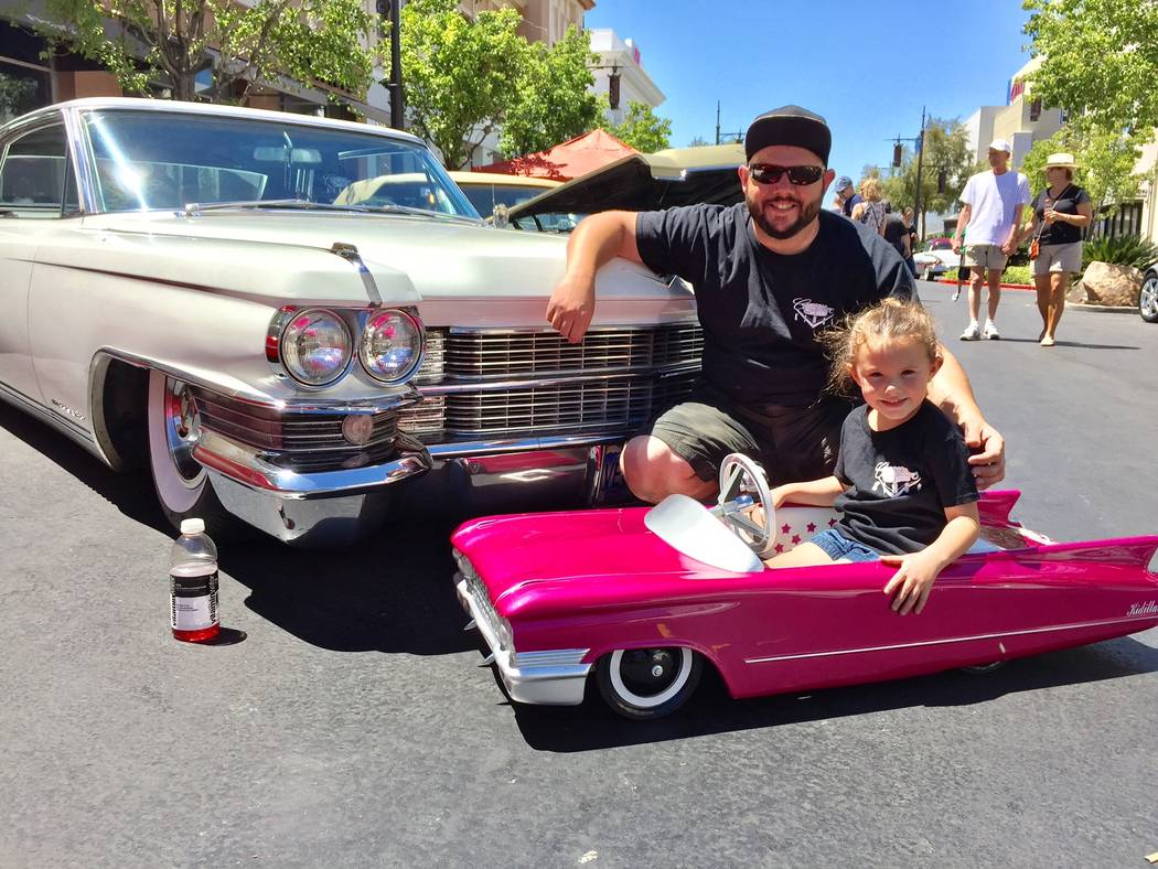 Findlay Cadillac Chad Solis and his daughter, Liv, 5, are seen by his 1963 Cadillac Coupe de Ville with a factory Eldorado package during the 12th annual Cadillac Through the Years car show April  ...