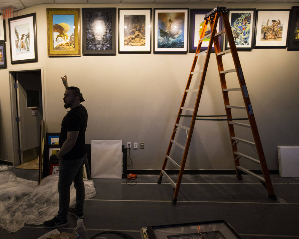 John Dolmayan points to original artwork while talking about the opening of the new location of his comic book store, Torpedo Comics, at 9300 Arroyo Crossing Parkway, in Las Vegas on Friday, May 5 ...