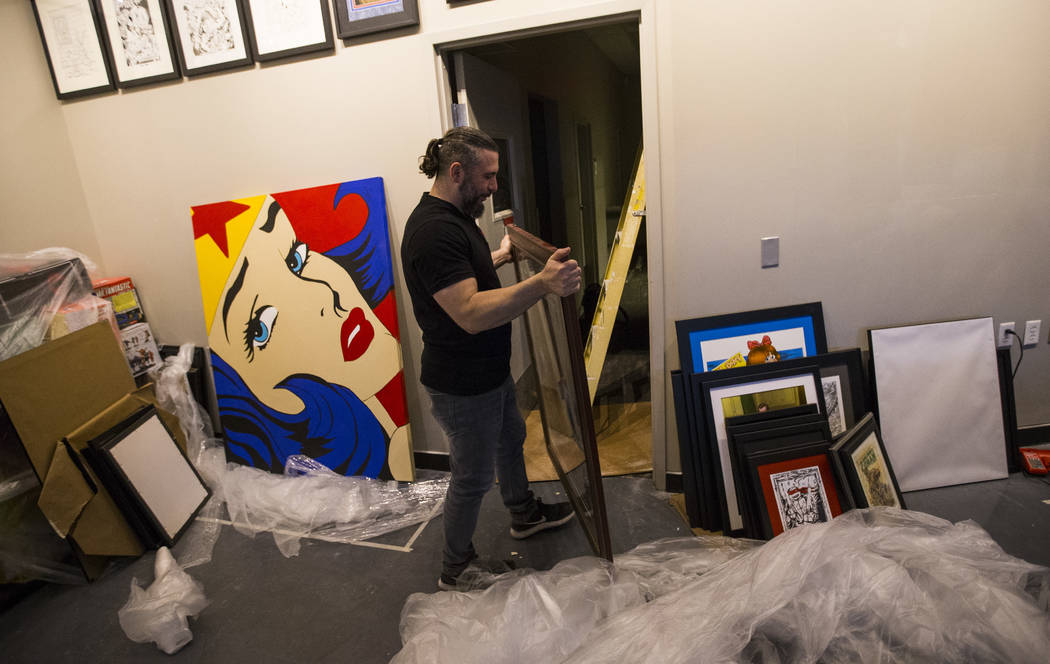 "John Dolmayan moves a ""Conan the Barbarian"" piece while setting up the new location of his comic book store, Torpedo Comics, at 9300 Arroyo Crossing Parkway, in Las Vegas on Friday, May 5, 2017. D ..."