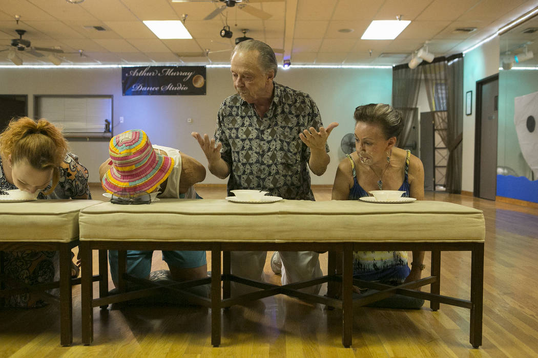 Toni Brasted, far right, and husband Lee Brasted, second from right, participate in an ice cream competition at Arthur Murray Dance Studio on Thursday, May 11, 2017 in Las Vegas. Bridget Bennett L ...