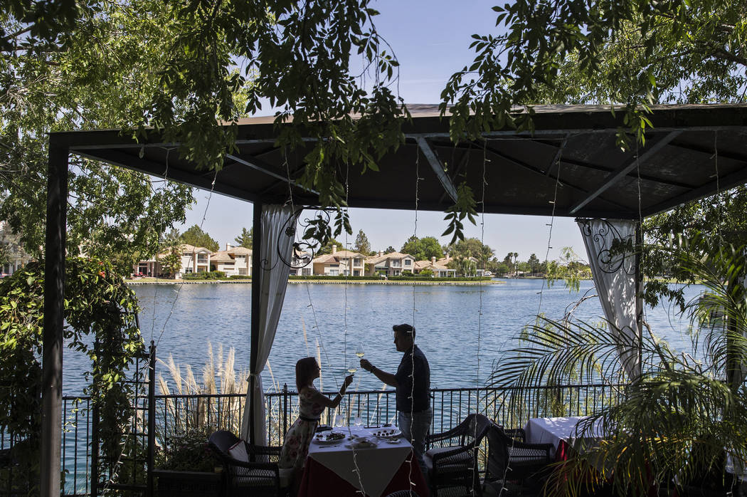 Madison Fisher, left, and Erik Bagi toast during lunch on the patio at Americana on Wednesday, May 10, 2017, in Las Vegas. Benjamin Hager Las Vegas Review-Journal @benjaminhphoto