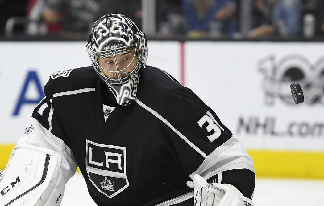 Los Angeles Kings goalie Ben Bishop watches the puck after defecting it during the third period of the team's NHL hockey game against the Winnipeg Jets, Thursday, March 23, 2017, in Los Angeles. T ...