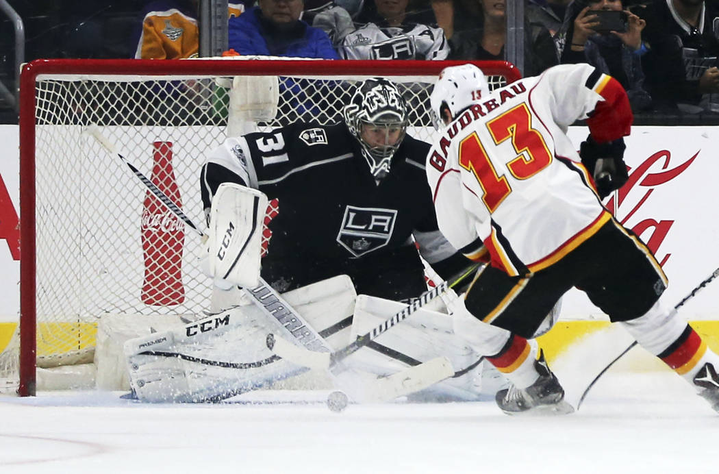 Calgary Flames left winger Johnny Gaudreau (13) looks for a shot against Los Angeles Kings goalie Ben Bishop (31) during the second period of an NHL hockey game in Los Angeles on Thursday, April 6 ...