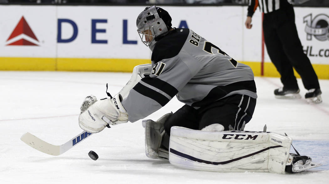 Los Angeles Kings goalie Ben Bishop (31) makes a save against the Vancouver Canucks during the first period of an NHL hockey game in Los Angeles, Saturday, March 4, 2017. (AP Photo/Alex Gallardo)