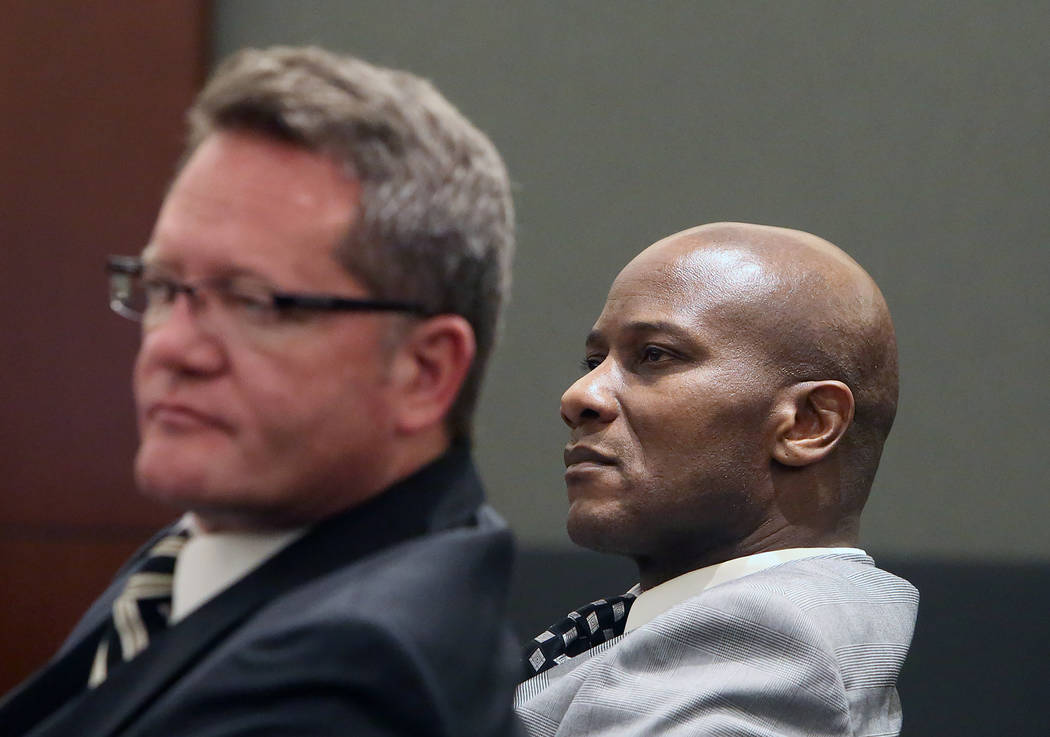 Frederick Richards, right, a former Bellagio club host accused of drugging and raping a woman, and his attorney, Robert Draskovich, appear in court at the Regional Justice Center on Wednesday, May ...