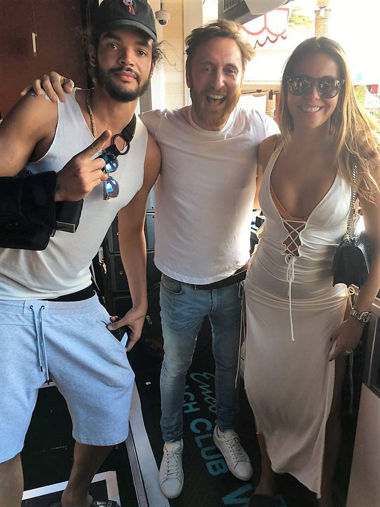 Joakim Noah, David Guetta and Isabelle Cutrim at Encore Beach Club in Las Vegas.