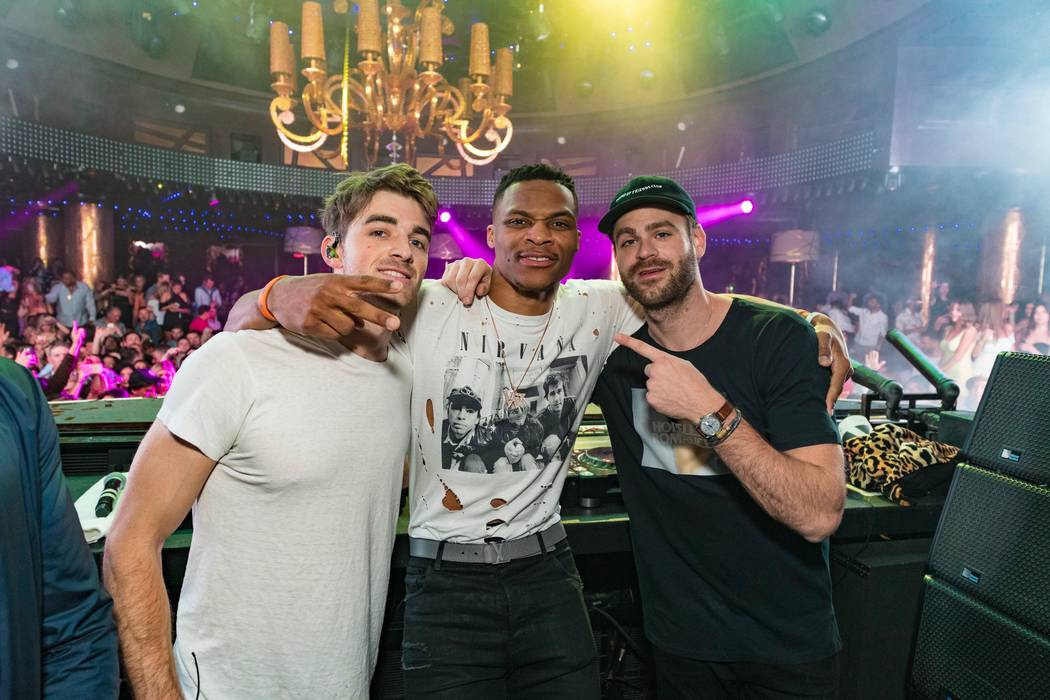 Russell Westbrook is flanked by The Chainsmokers at XS at Encore in Las Vegas.