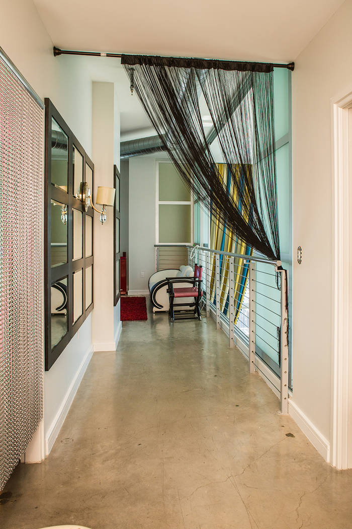 A hallway connects the master suite and upstairs rooms. (Tonya Harvey Real Estate Millions)