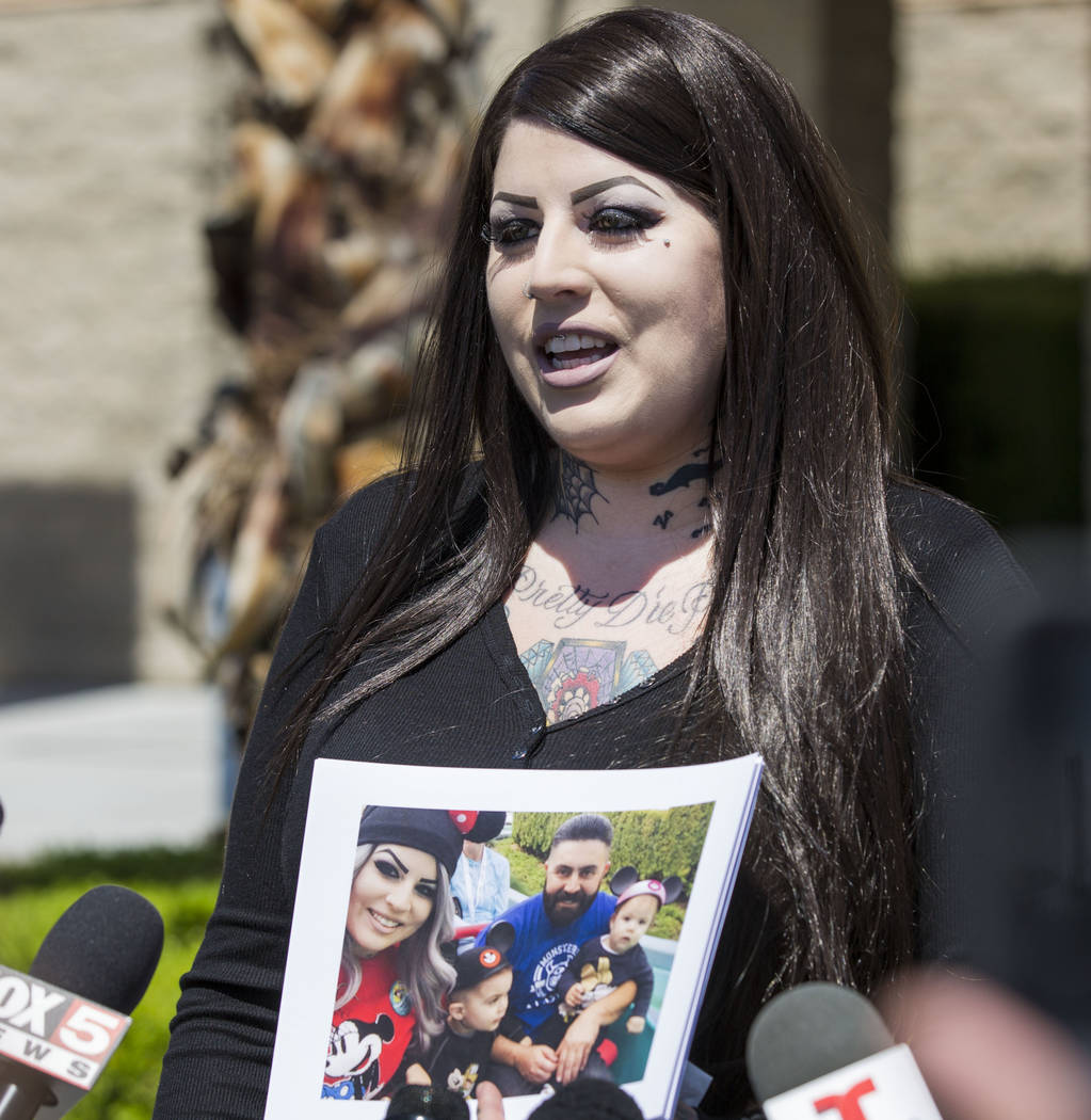Julie Campos holds a photo of her husband, homicide victim Luis Campos, and their children at the Metropolitan Police Department's downtown area command in Las Vegas, Monday, May 8, 2017. Elizabet ...