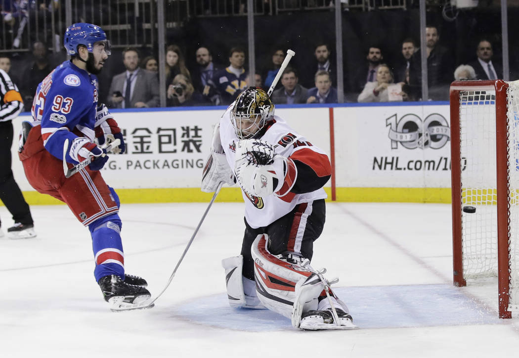 New York Rangers' Mika Zibanejad (93) shoots the puck past Ottawa Senators' Craig Anderson (41) for a goal during the second period of Game 6 of an NHL hockey Stanley Cup second-round playoff seri ...