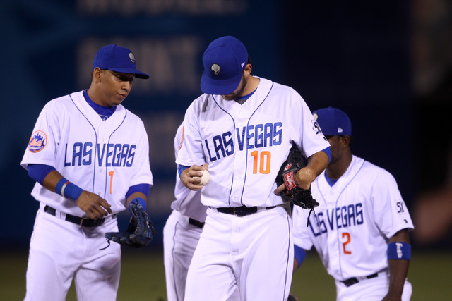 Las Vegas 51s starting pitcher Tyler Pill looks at the ball after giving up six runs in one and 2/3 innings to the Fresno Grizzlies during the 51s home opener Friday, April 17, 2015, at Cashman Fi ...