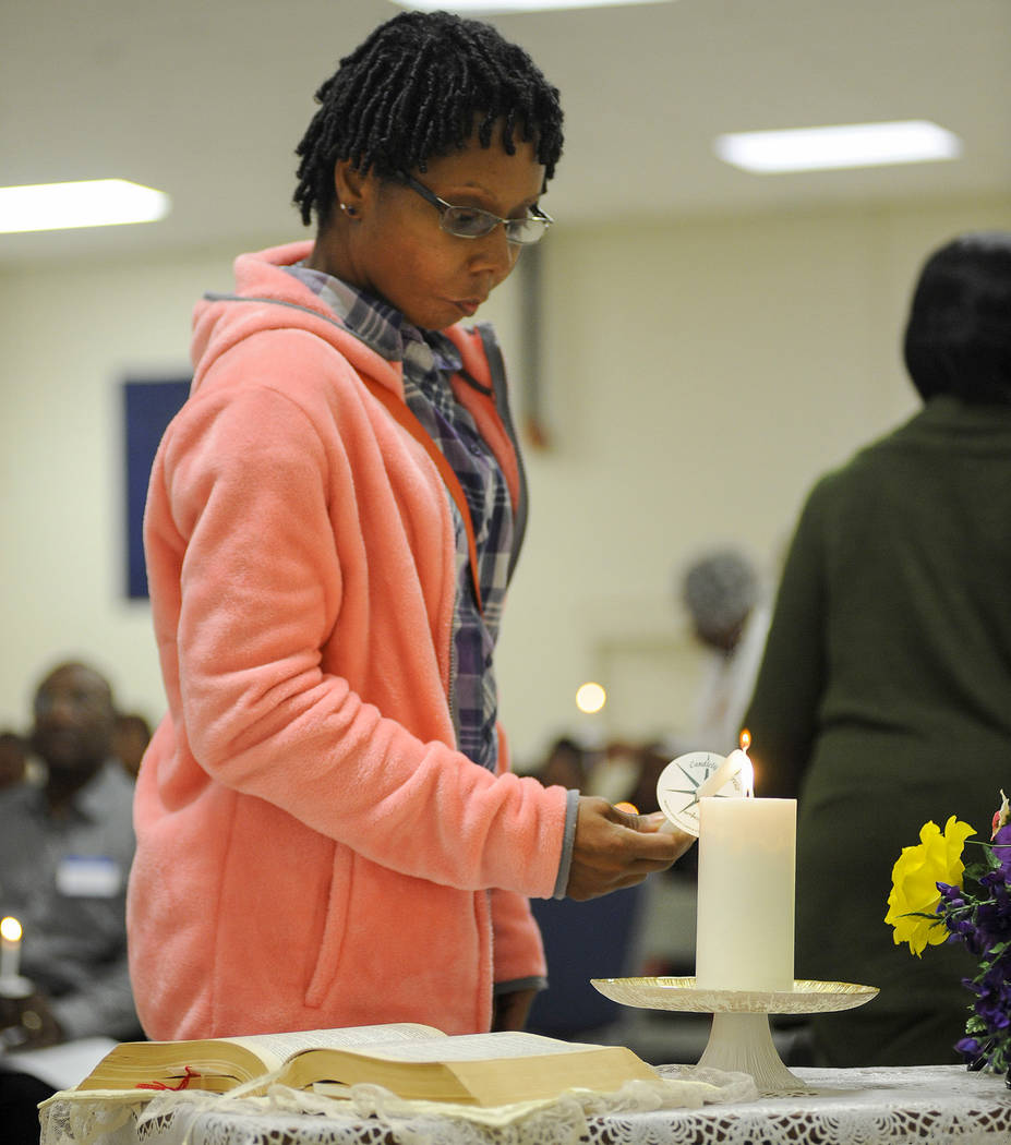 Tabitha Julkes lights a candle during a ceremony near Tuskegee, Ala., on Monday, April 3, 2017, to commemorate the roughly 600 men who were subjects in the Tuskegee syphilis study. Julkes' great-g ...