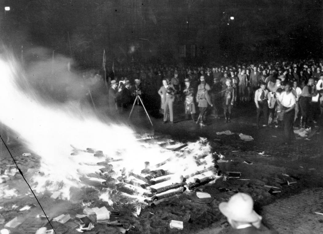 "A crowd gathers to witness thousands of books, considered to be ""un-German,"" burn in Opera Square in Berlin, Germany, during the Buecherverbrennung book burnings on May 10, 1933. ..."